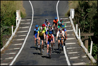 Cyclists from Sunshine Coast Cycle Club cross Vic Olsen Bridge on the Mary River, wearing snorkels in silent protest. The region is a popular training area for the coast's best cyclists.
